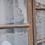 window panes with frozen snow flakes