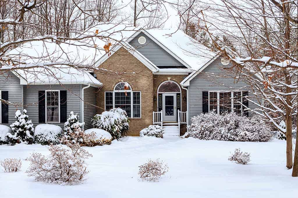 home featuring siding in the winter