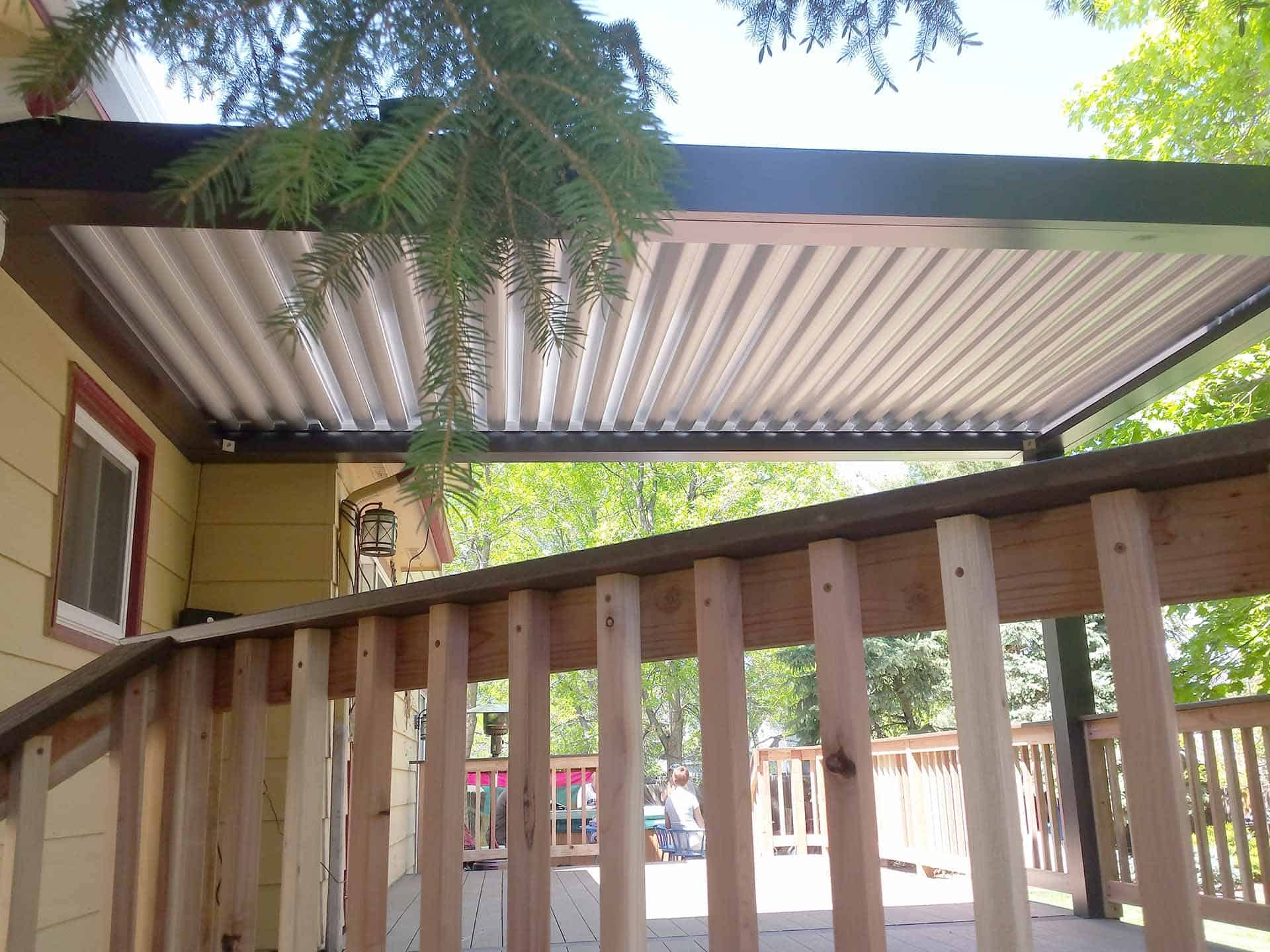pic of a job in loveland, co featuring a new deck and louvered patio cover