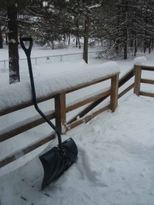 pic of a shovel sitting on a snowy deck