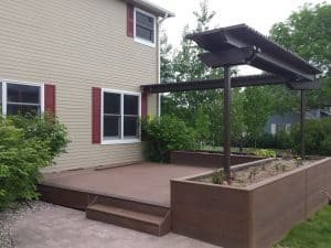 picture of a deck built in larimer county featuring a planter box and arbor