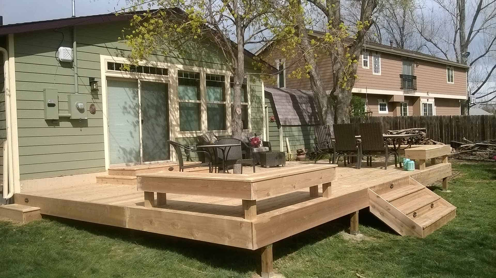 pic of a wood deck built in Loveland featuring built in seating and lighting